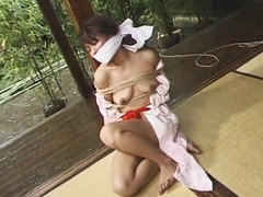 Tied and restrained Japanese woman controlled